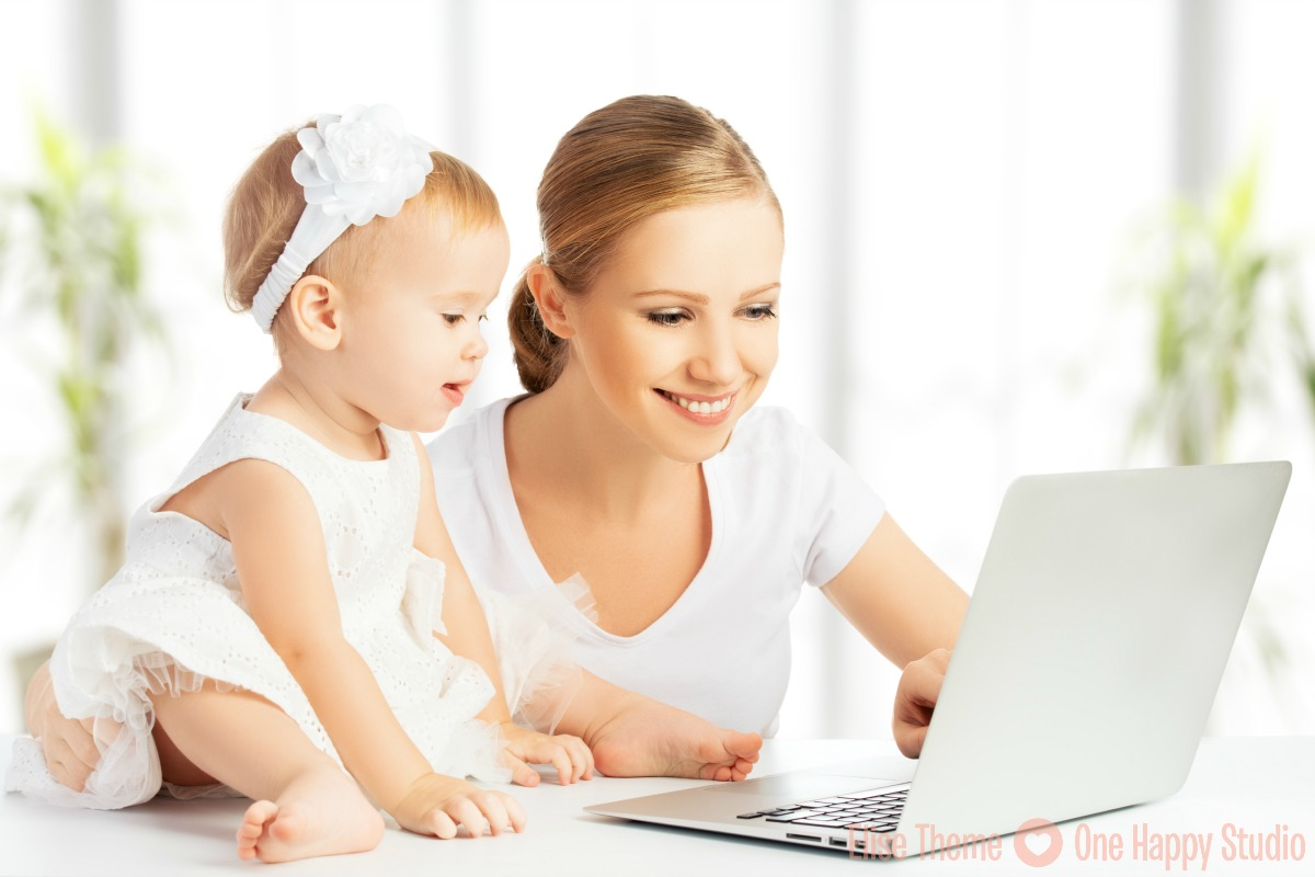 Mom and baby with laptop computer working from home